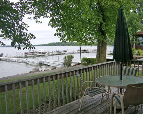 Scenic outdoor patio with patio furniture and lake view.