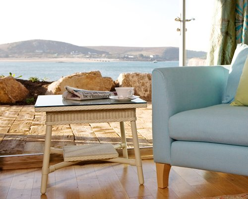 An outdoor sofa with a view of the ocean.