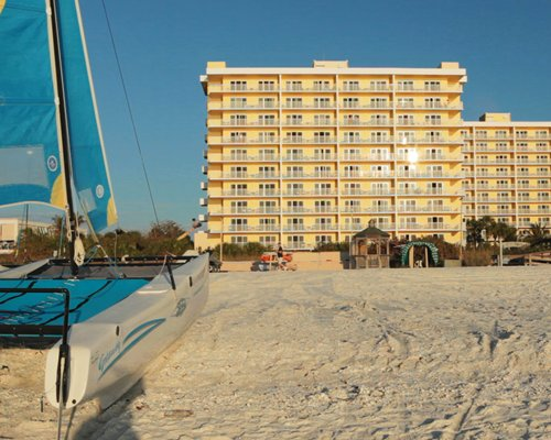 A beach view of the multi story The Charter Club resort.
