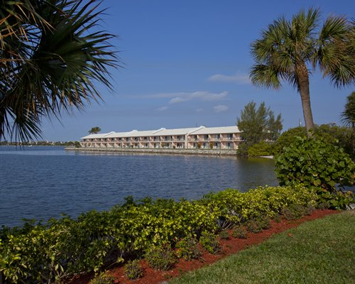 Scenic exterior view of Palm Beach Resort alongside the water.