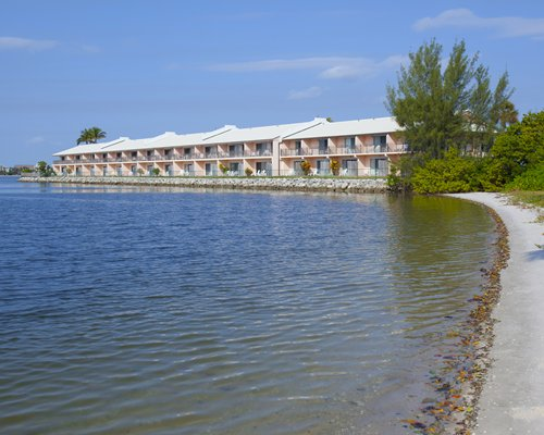 View of Palm Beach Resort alongside water.