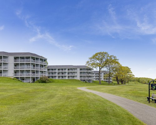 An aerial view of Samoset Resort with a well maintained golf course on the waterfront.