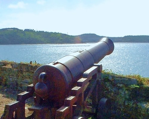 A cannon overlooking the water.