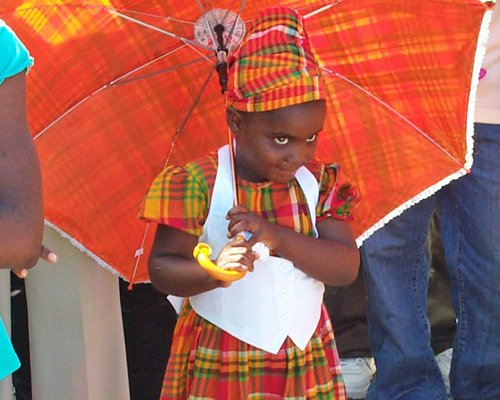 Child holding an umbrella.