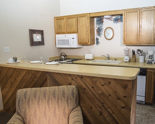 A well equipped kitchen with a bar.