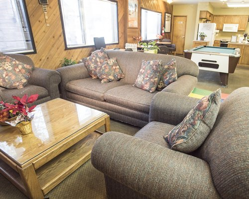 Furnished recreation room with open plan kitchen living area and pool table.