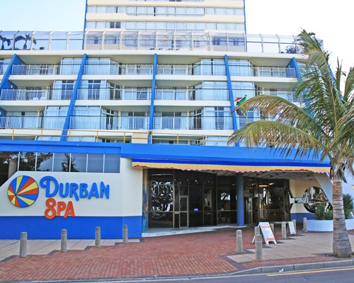 Exterior view of the entrance to the Durban Spa with multiple unit balconies.
