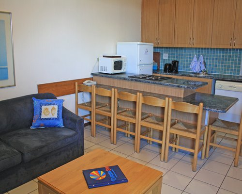 An open plan living and kitchen area with a breakfast bar.