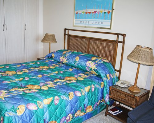 A well furnished bedroom with a double bed and two lamp stands.
