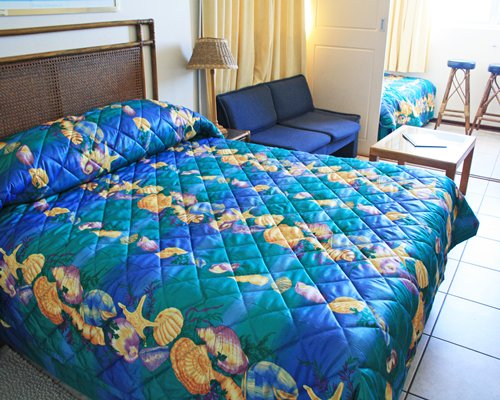 A well furnished bedroom with double bed.