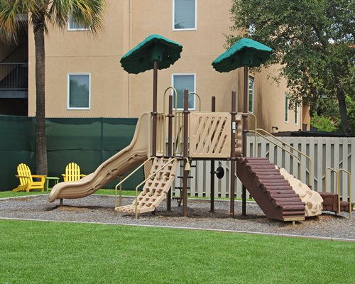 An outdoor play area for kids among landscaping.