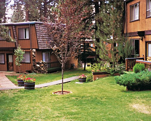 Scenic exterior view of Heavenly Valley Townhouses among a wooded area.