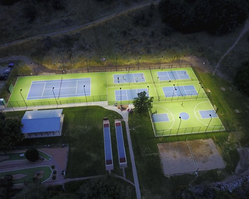 An aerial view of outdoor basketball and tennis courts.