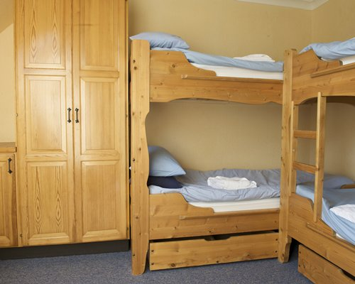 Two bunk beds with large storage closet.