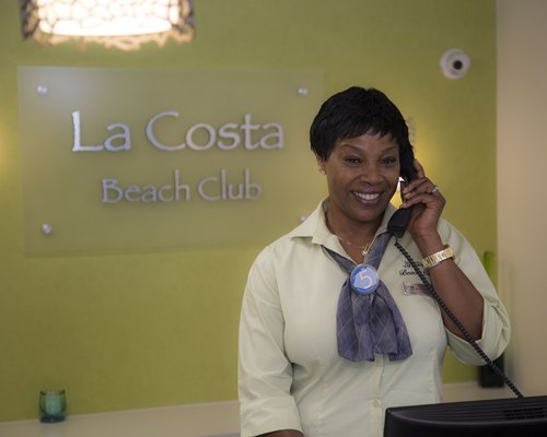 A woman speaking on the phone at the reception area.