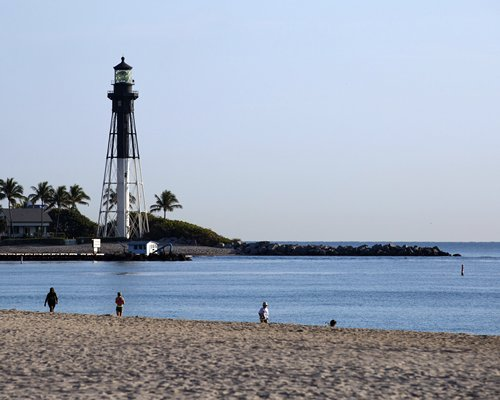 An outdoor beach with a lighthouse.