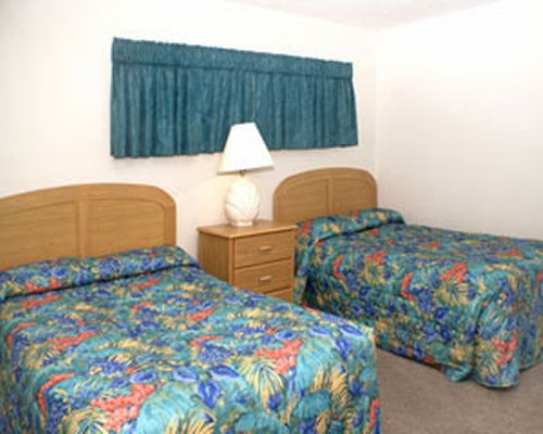 A well furnished bedroom with two double beds.