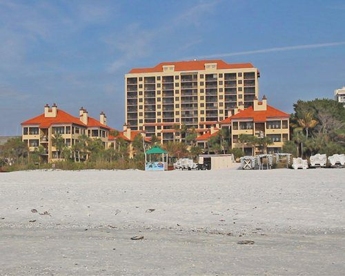 Exterior view of Eagle's Nest Beach Resort from the beach.