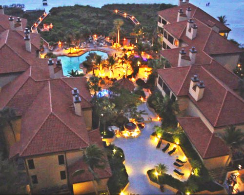 An aerial view of Eagle'S Nest Beach Resort with outdoor swimming pool and night lights.