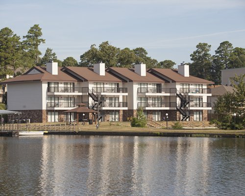 Lake view of multi story unit resort with private balconies.