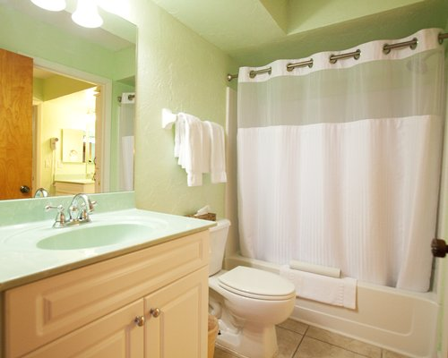 A bathroom with bathtub and sink vanity.
