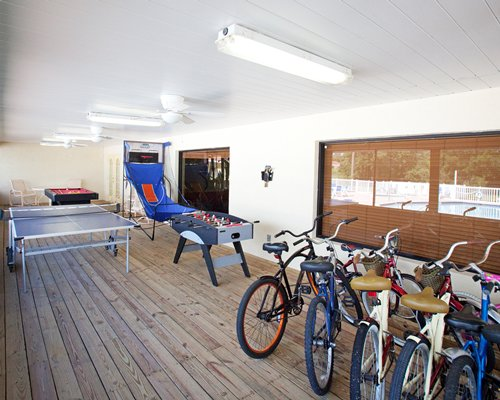 An outdoor recreation room with multiple recreational amenities.
