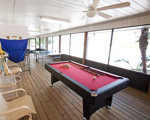An indoor recreation room with a variety of casual recreational amenities.