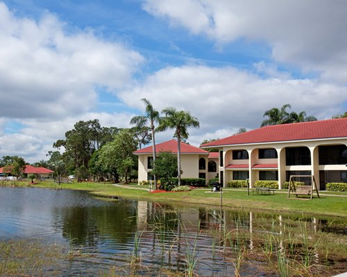 Lake view of the multi story villas resort.
