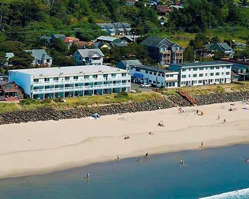 An aerial view of Rockaway Beach Resort alongside the beach.
