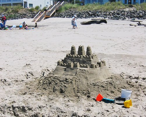 A sandcastle on the beach.