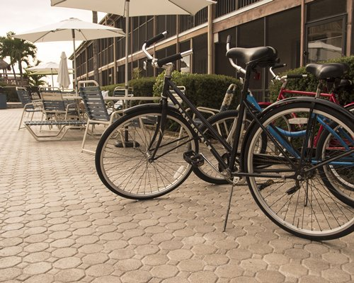 An outdoor bicycle parking area alongside patio furniture.