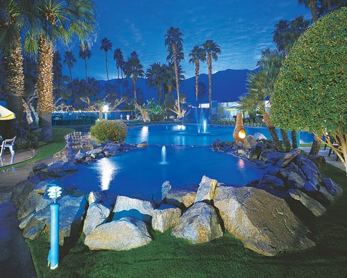 A landscape view of the pool in the night.