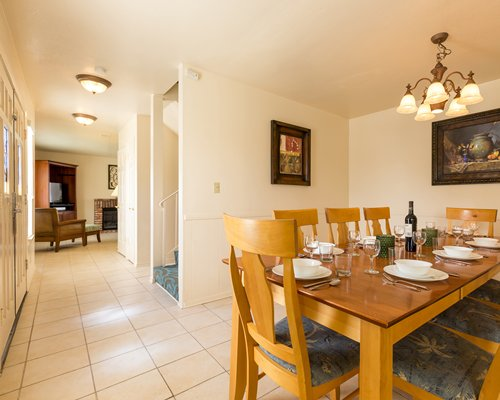 A well furnished dining area alongside living room and fireplace.