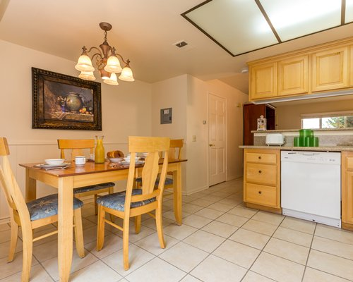 A well furnished dining area alongside a kitchen.