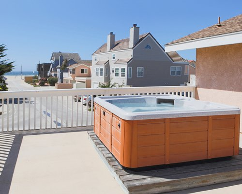 An outdoor hot tub with a view of multi story resort units.