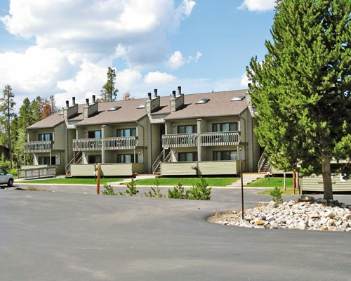 Exterior view of The Pines at Meadow Ridge with car parking.