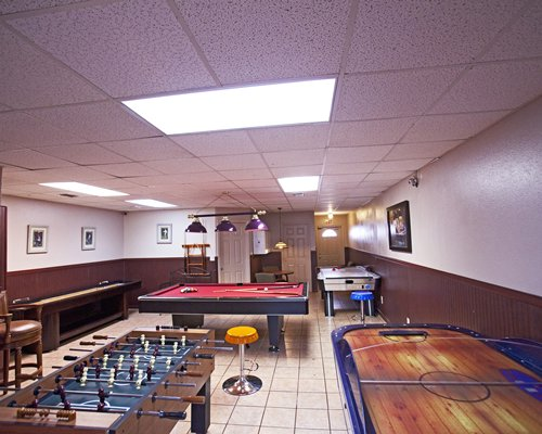 An indoor play area with pool table table hockey and foosball.