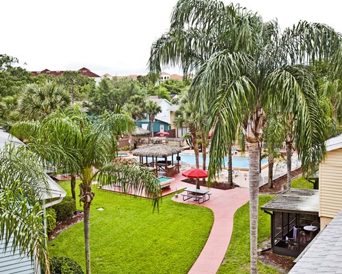 Scenic pathway to outdoor swimming pool and to the other units at Florida Vacation Villas.