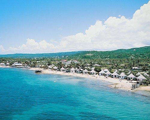 An aerial view of multiple units at Club Caribbean alongside beach.