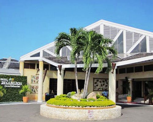 Exterior view of entrance to a unit at Club Caribbean with palm trees.