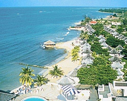 An aerial view of a Club Caribbean Resort alongside the ocean.
