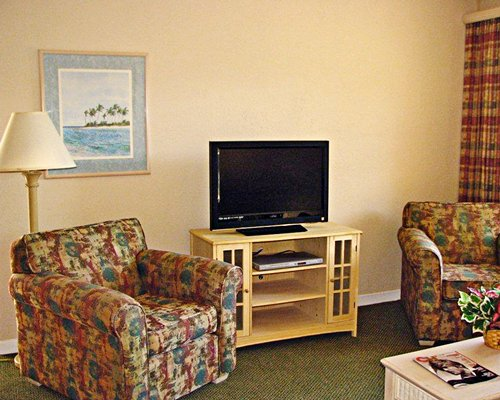 A portion of a living area with a television.