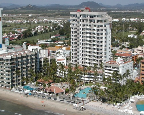 An aerial view of the Inn at Mazatlan alongside beach.
