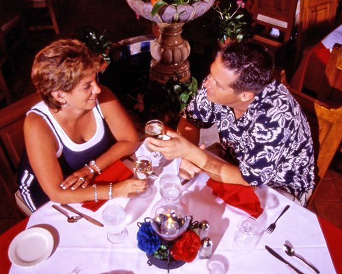 Couple drinking at a fine dining restaurant.
