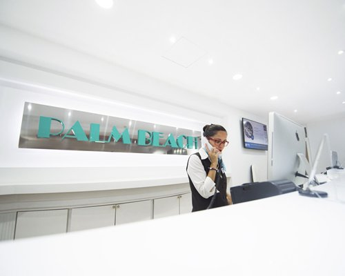 A woman speaking on the phone in the resort's reception area.