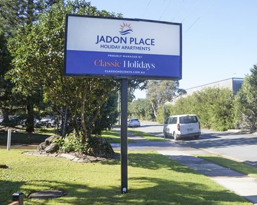 A signboard of the Jadon Place resort on the beach.