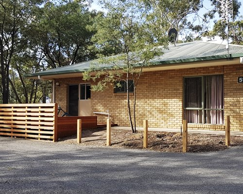 Exterior view of Kyneton Bushland Resort surrounded by wooded area.