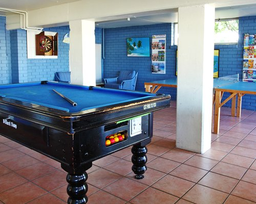 An indoor play area with a pool table.