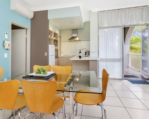 A well equipped kitchen with glass top dining area.