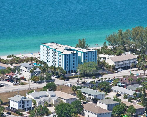 An aerial view of the Cameron Cove resort alongside the Caribbean Sea.
